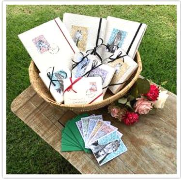 Papeis de carta,cartões,álbuns de fotos.Confeccionados em papeis artesanais.