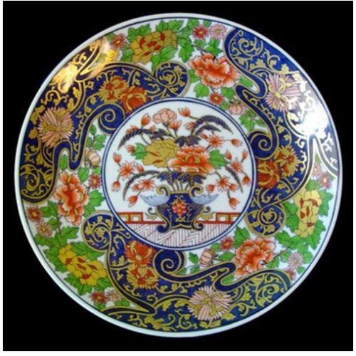 Pratos pintados à mão por Maria Augusta Rebouças, encontrados na Porcelana21