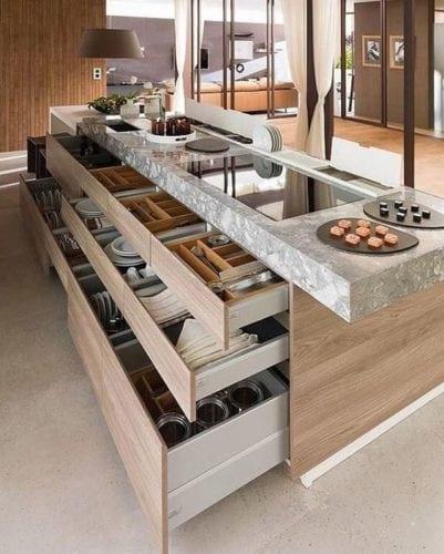 Ilha de cozinha completa, com gavetas, cooktop e cuba.