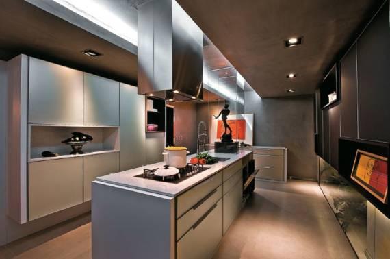 ilha na cozinha totalmente funcional, tudo fica nela. Cooktop, cuba, forno e gavetas. Projeto mais moderno,.