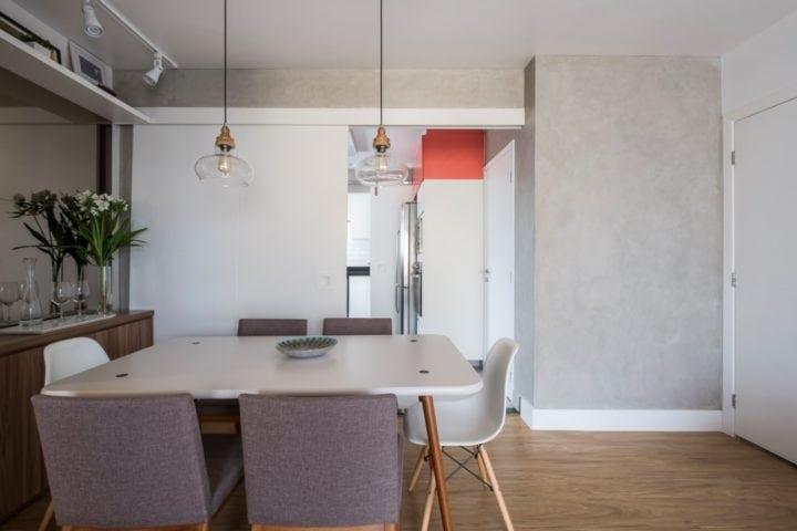 Sala de jantar com parede concreto assinado pelo sp estudio