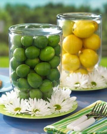 Dicas e inspirações para receber os amigos nos jogos da Copa do Mundo 2018. Centro de mesa usando limão verde e siciliano.