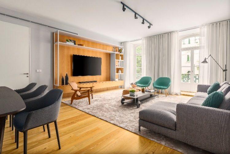 Mix de mobiliário europeu e clássicos do design brasileiro em apartamento em Lisboa