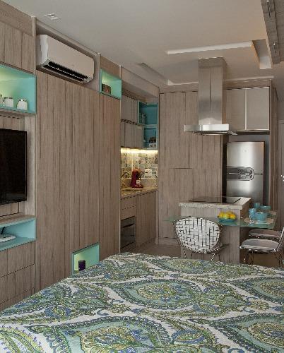 apartamento integrado com marcenaria assinado por Andrade e Mello Arquitetura e foto de Luis Gomes