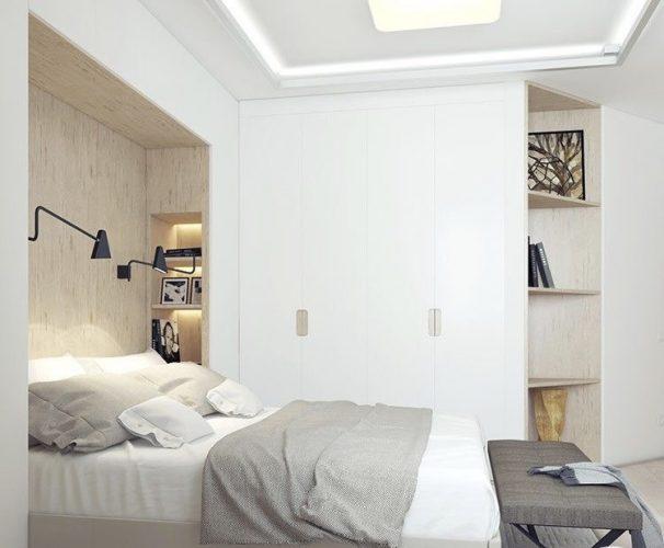 Armário com cama embutida e nichos iluminados na lateral.