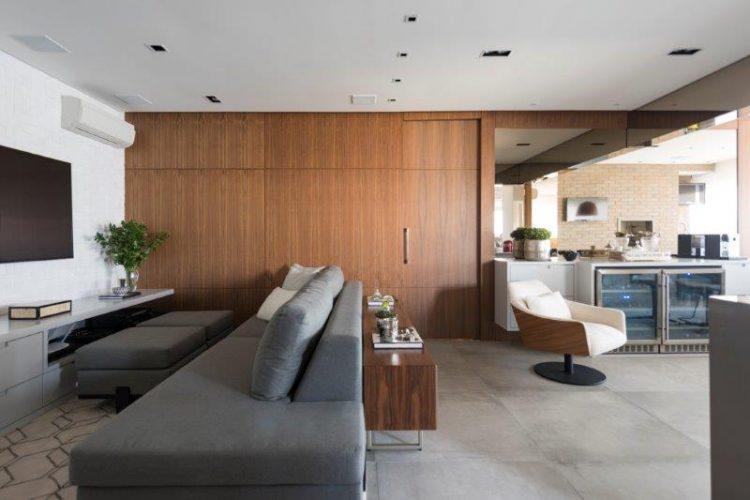 Sala integrada com varanda no projeto de Patricia Pasquini
