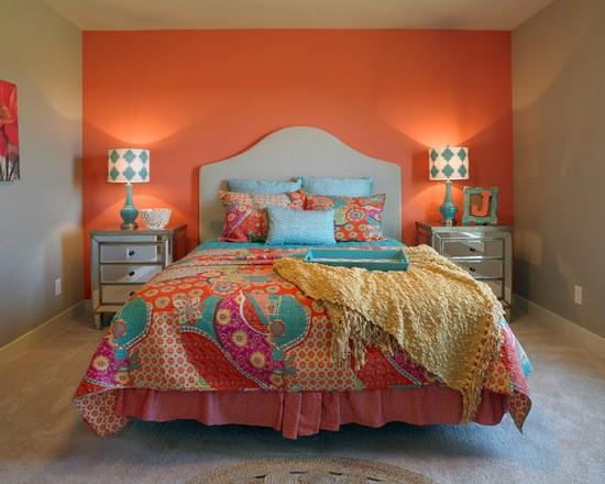 Os Signos e suas cores na decoração. Laranja é a cor do signo de Leão e foi usada para pintar a parede de funda da cama.