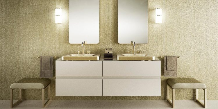 Banheiro de luxo, bancada branca com cubas douradas da marca Armani Casa