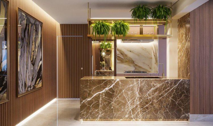 Sofisticação em apartamento com 100m². Cozinha com ilha em mármore, prateleira dourada em cima a parede ripada em madeira ao lado