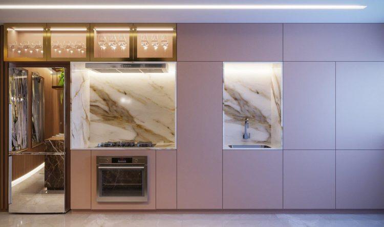 Sofisticação em apartamento com 100m². Cozinha com armarios rosa. geladeira espelhada a revestimento de mármore no nicho do fogão e cuba