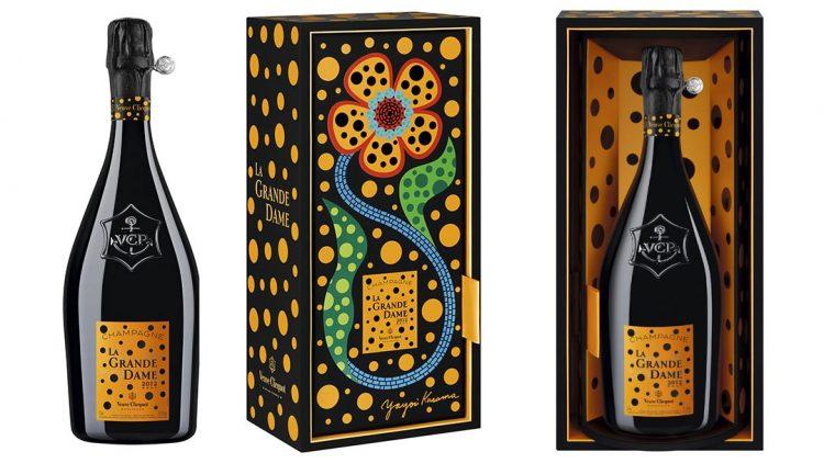 collabs .Yayoi Kusama ilustra a garrafa da champagne para celebrar o novo vintage da Maison Veuve Clicquot. Embalagem preta com bolinhas amarelas e uma flor colcorida