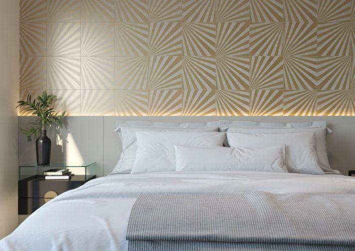 Paredes geometricas, no fundo da cama com revestimento em azulejo com desenhos de raios dourados