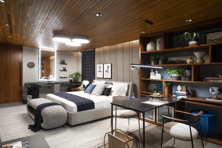 Ambientes abordam o novo morar no Janelas CASACOR /SC, mostra de decoração. Quarto com teto revestido em madeira, estante de maeira escura ao lado