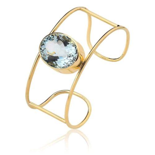 Presente da natal, pulseira em ouro com uma pedra azul no meio