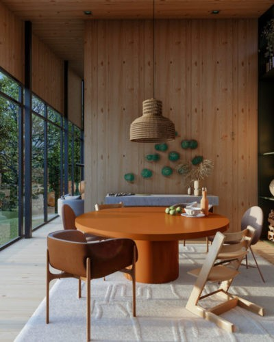 Casa na Toca - mostra virtual a partir de uma casa real na Patagônia Chilena. Sala de jantar com uma mesa redonda marrom , a fundo uma parede revestida em madeira