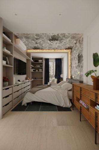 Quarto com uma estante em frente a cama com prateleiras e tv na parede.
