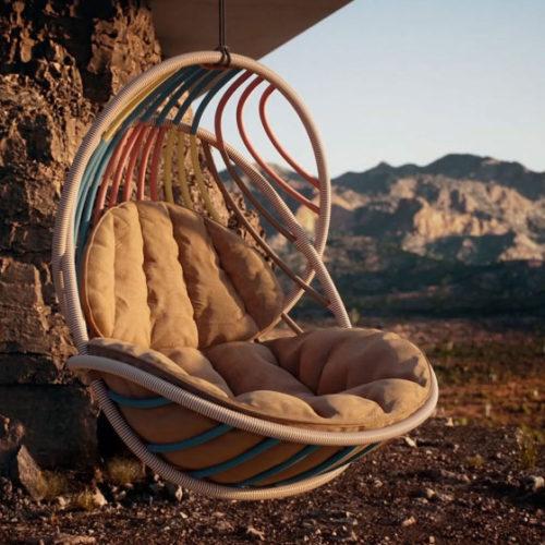 Tendências, Kida, cadeira de balança da marca DEDON. Parece um ninho, com varias tiras coloridas;