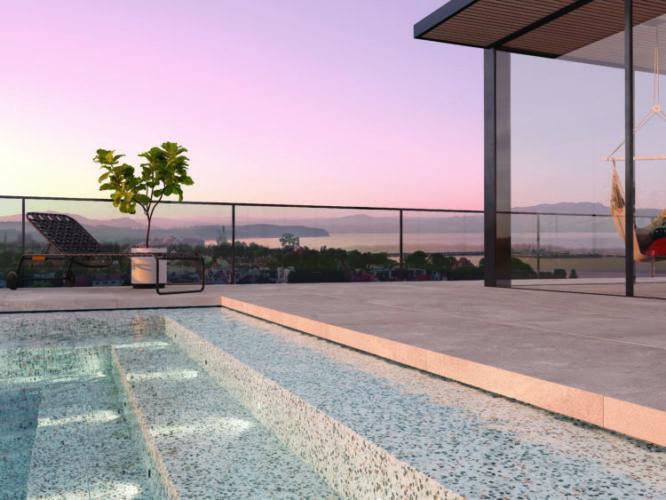 Roca Cerâmica, linha Flake, no piso na borda da piscina em uma cobertura