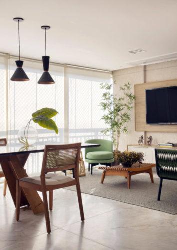 Varanda fechada, integrada a sala e com espaço gourmet